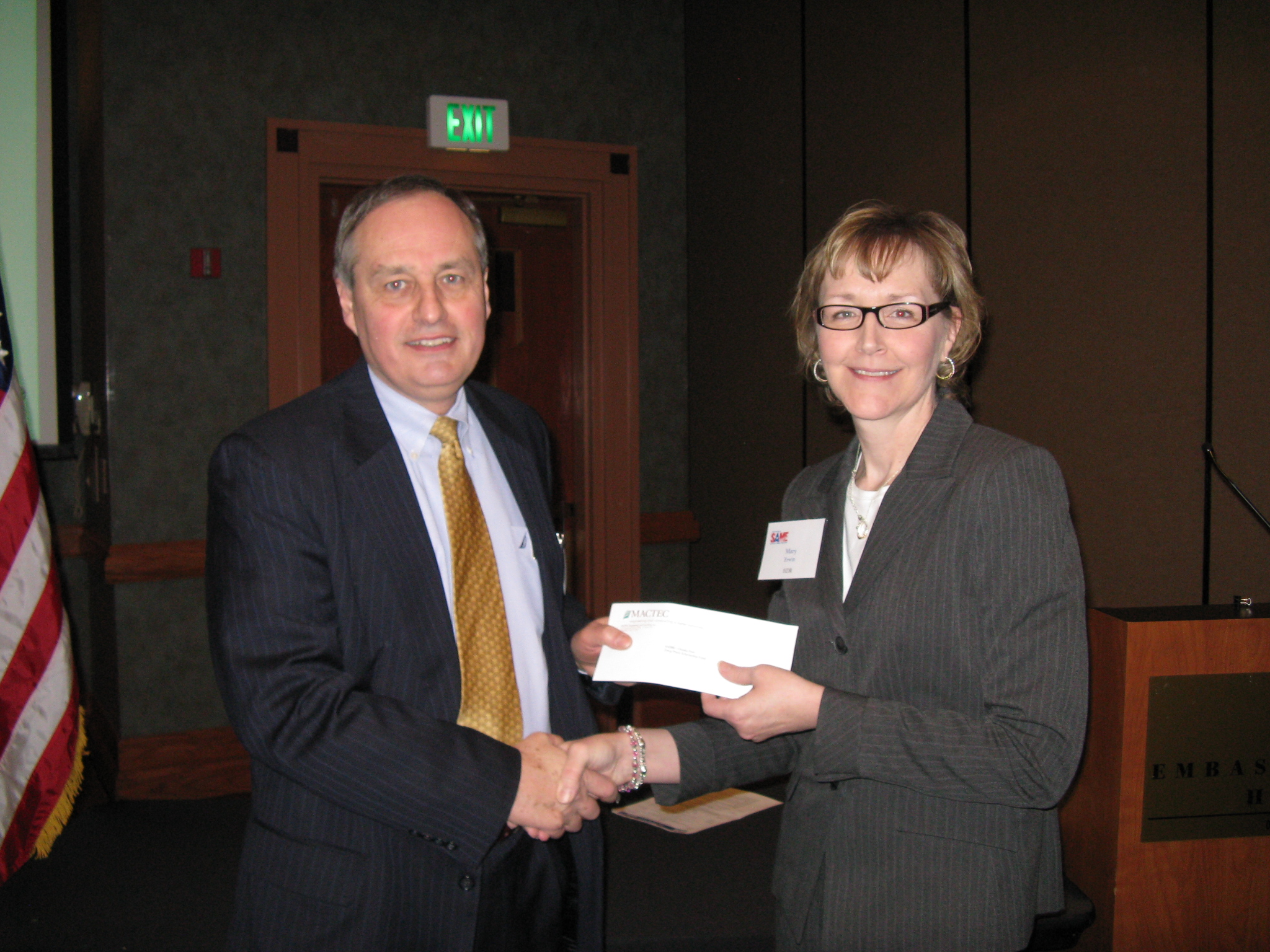MACTEC (Al Fillip) presents check to Omaha Post President Mary Erwin for the Doug Plack Scholarship Fund.