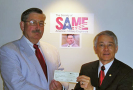 Jerry Adams of Kansas City Post presents check to Roger Wozny.